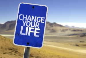 Change your Life sign with a desert background