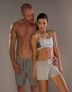 Young Fitness Enthusiasts Flaunting Perfect Abs. Expressing Prop